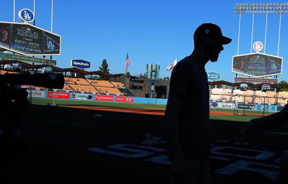 Chris Sale is silhouetted with the outfield at Dodger Stadium in the background.