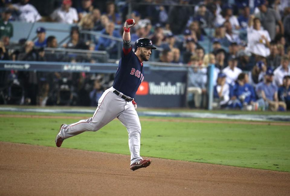 Los Angeles, CA - 10/27/2018 - Red Sox Steve Pearce reacts his solo home run while rounding second base in the eighth inning. Los Angeles Dodgers hosted the Boston Red Sox in Game 3 of the World Series at Dodger Stadium. (
