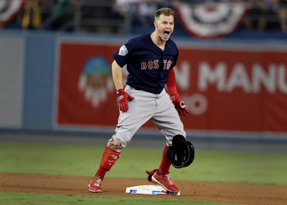 Los Angeles, CA - 10/27/2018 - Brock Holt reacts after hitting a double in the ninth inning. The Los Angeles Dodgers host the Boston Red Sox in Game 4 of the World Series at Dodger Stadium. (Jim Davis/Globe staff)