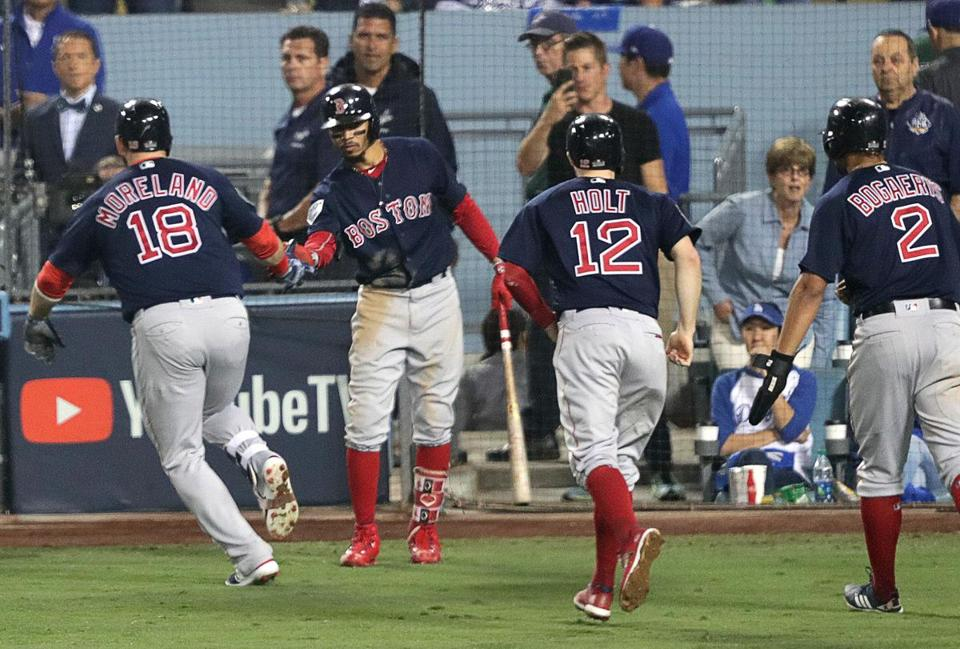 Mitch Moreland celebrates his home run with Mookie Betts as Brock Holt and Xander Bogaerts look on.