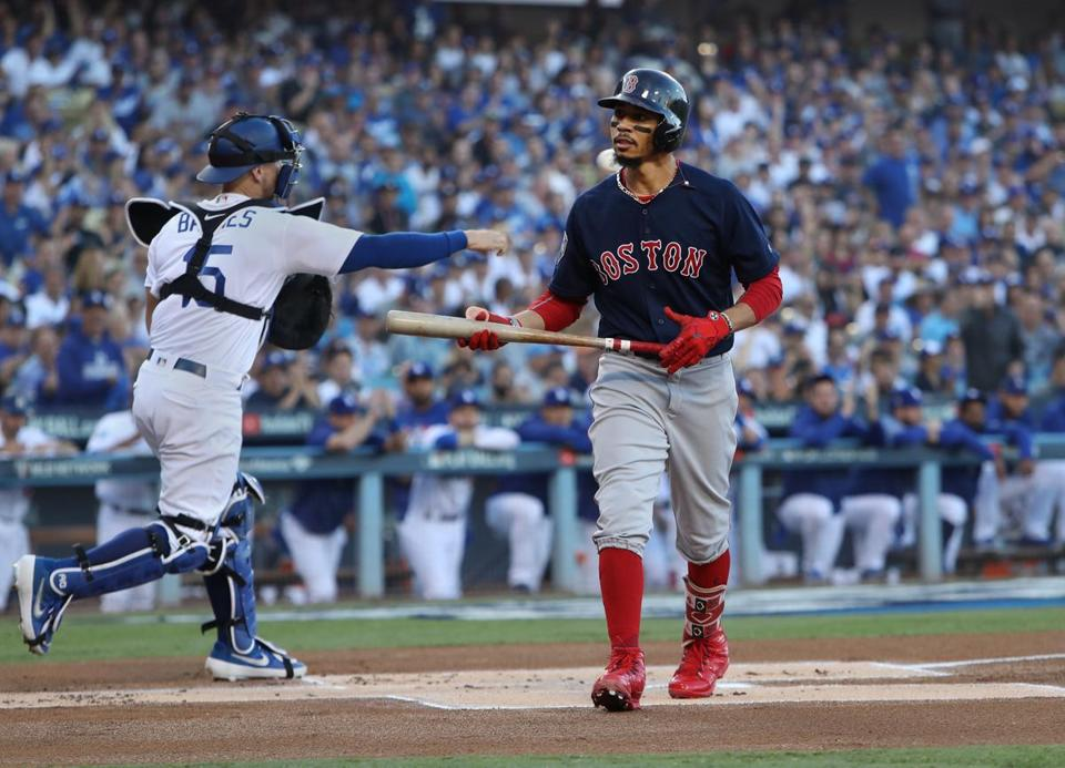 Mookie Betts walked off after striking out in the first inning.