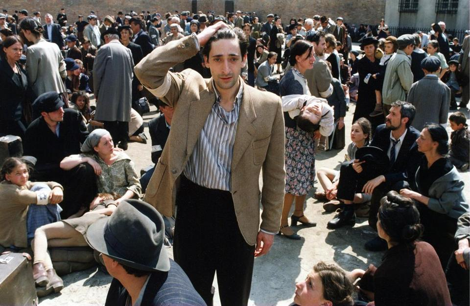 "Adrien Brody (center) in ""The Pianist."""