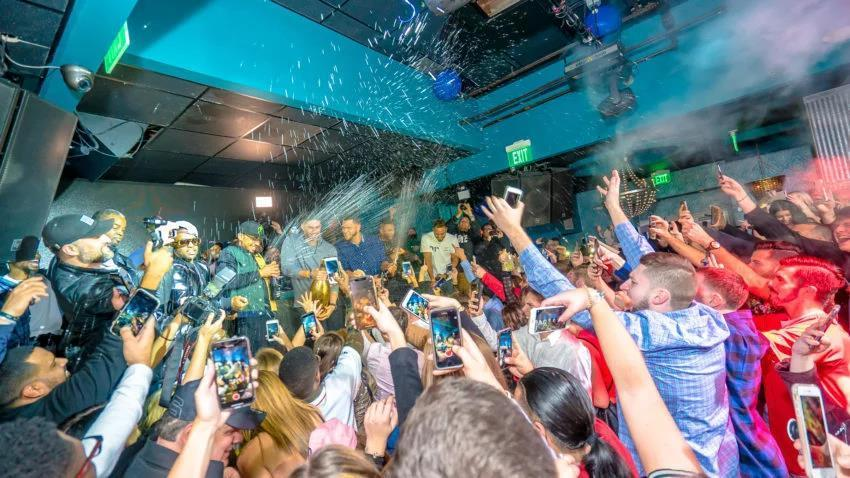 Red Sox players spray champagne into the crowd at Icon Nightclub.