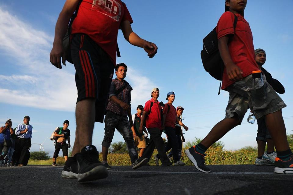 JUCHITAN DE ZARAGOZA, MEXICO - NOVEMBER 01: Members of the Central American caravan head out at dawn for their next destination on November 01, 2018 in Juchitan de Zaragoza, Mexico. The group of migrants, many of them fleeing violence in their home countries, took a rest day on Wednesday and resumed their journey towards the United States border on Thursday. As fatigue from the heat, distance and poor sanitary conditions has set in, the numbers of people participating in the trek has slowly dwindled but a significant group are still determined to get to the United States. On Monday an official said that the Pentagon will deploy up to 5,000 active-duty troops to the U.S.-Mexico border in an effort to prevent members of the migrant caravan from illegally entering the country. (Photo by Spencer Platt/Getty Images)