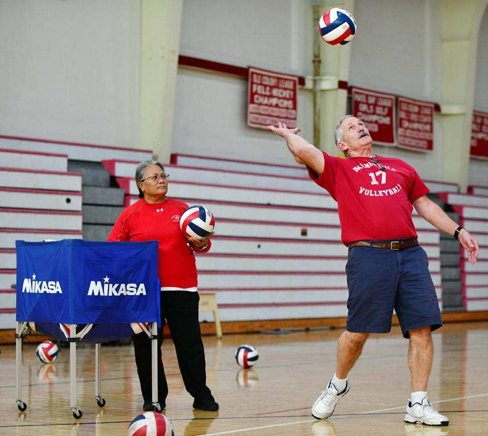 HYANNIS - Barnstable High School volleyball assistant coach Marylou Robles is ready with the next ball as head coach Tom Turco serves to his players during practice, Wednesday, October 31, 2018. (Christine Hochkeppel for the Boston Globe)