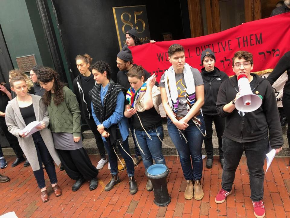 Protesters stood outside the Massachusetts GOP office singing songs and telling stories.