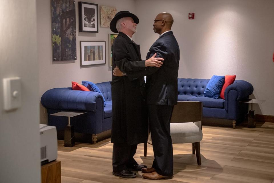 Rabbi Jeffrey Myers (left) of the Tree of Life congregation embraced Rev. Eric S.C. Manning of Charleston, S.C.