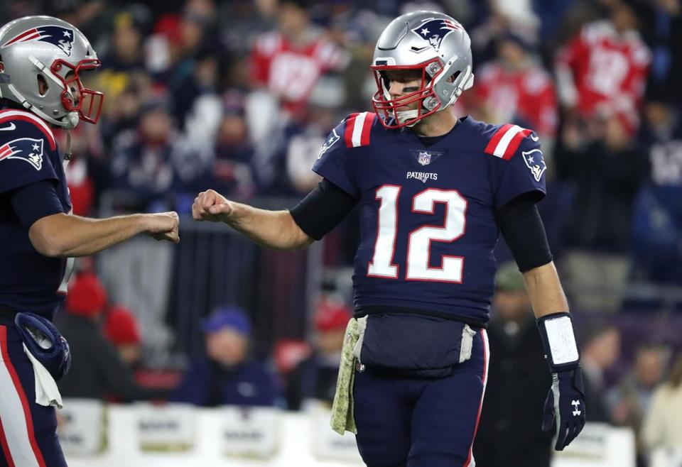 Tom Brady's fist bumped into a teammate during the warm-up.