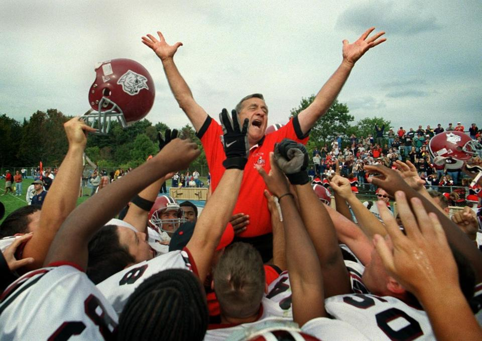 Brockton coach Armond Colombo was hoisted up by his players following his 300th career victory in 2000.