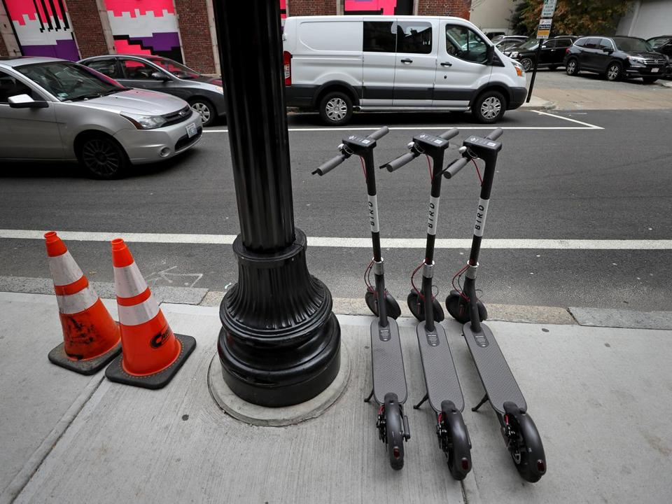 PROVIDENCE, RI - 11/05/2018: Scotters left on Weybosset Street downtown Providence. People riding scooters and scooters just abandoned in the middle of sidewalks in downtown Providence RI. (David L Ryan/Globe Staff ) SECTION: METRO TOPIC 06scooter
