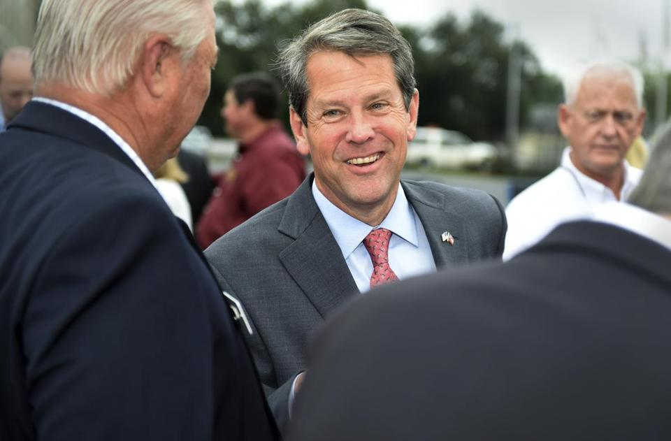 Georgia Republican gubernatorial candidate Brian Kemp greets supporters during a campaign stop at Daniel Field in Augusta, Ga., Monday, Nov. 5, 2018. (Michael Holahan/The Augusta Chronicle via AP)