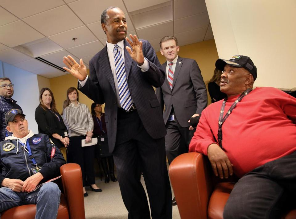 Boston, MA - November 07, 2018: United States Secretary of Housing and Urban Development Ben Carson, center, arrives for a discussion with veterans including John Watt, left, and Michael Pearson, right, during a visit to the New England Center and Home for Veterans in Boston, MA on November 06, 2018. Ben Carson, United States Secretary of Housing and Urban Development visited the New England Center and Home for Veterans in Boston. (Craig F. Walker/Globe Staff) section: metro reporter: