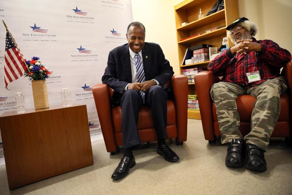 Boston, MA - November 07, 2018: United States Secretary of Housing and Urban Development Ben Carson, left, shares a laugh with veterans including Gregory Gregg Sr., right, during a discussion at the New England Center and Home for Veterans in Boston, MA on November 06, 2018. Ben Carson, United States Secretary of Housing and Urban Development toured the New England Center and Home for Veterans in Boston. (Craig F. Walker/Globe Staff) section: metro reporter: