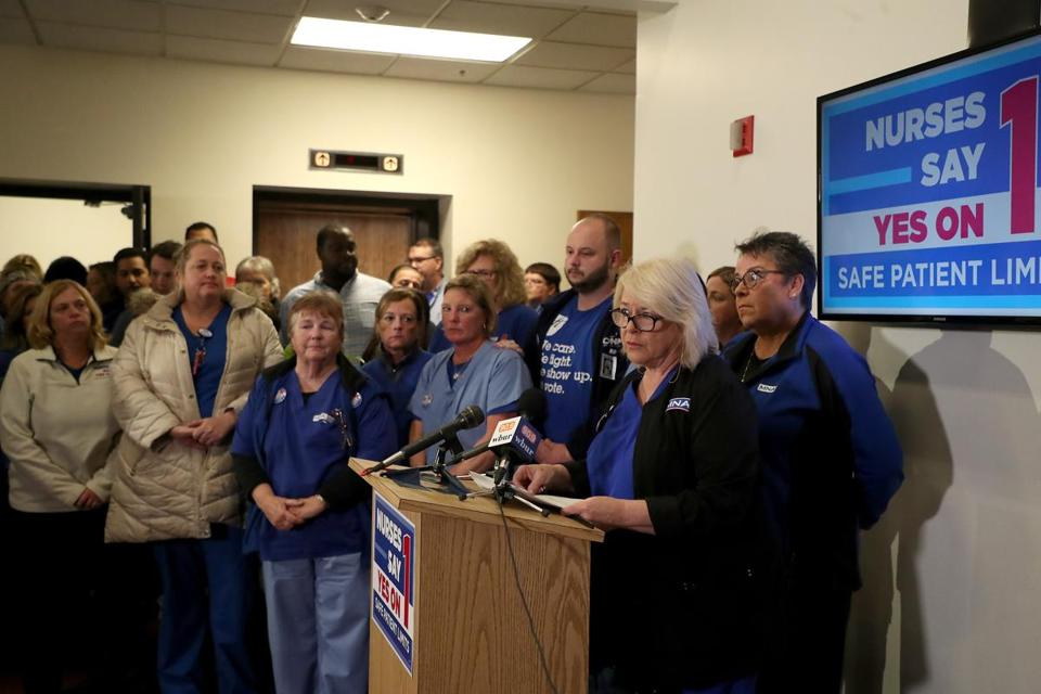 President of the Massachusetts Nurses Association Donna Kelly-Williams flanked by nurses conceding on the ballot question Yes on 1 at the Massachusetts Nurses Association.