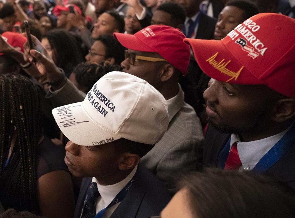 WASHINGTON, DC - OCTOBER 26: (AFP OUT) Attendees listen as U.S. President Donald Trump addresses young black conservative leaders from across the country as part of the 2018 Young Black Leadership Summit in the East Room of the White House on October 26, 2018 in Washington, DC. (Photo by Chris Kleponis - Pool/Getty Images)