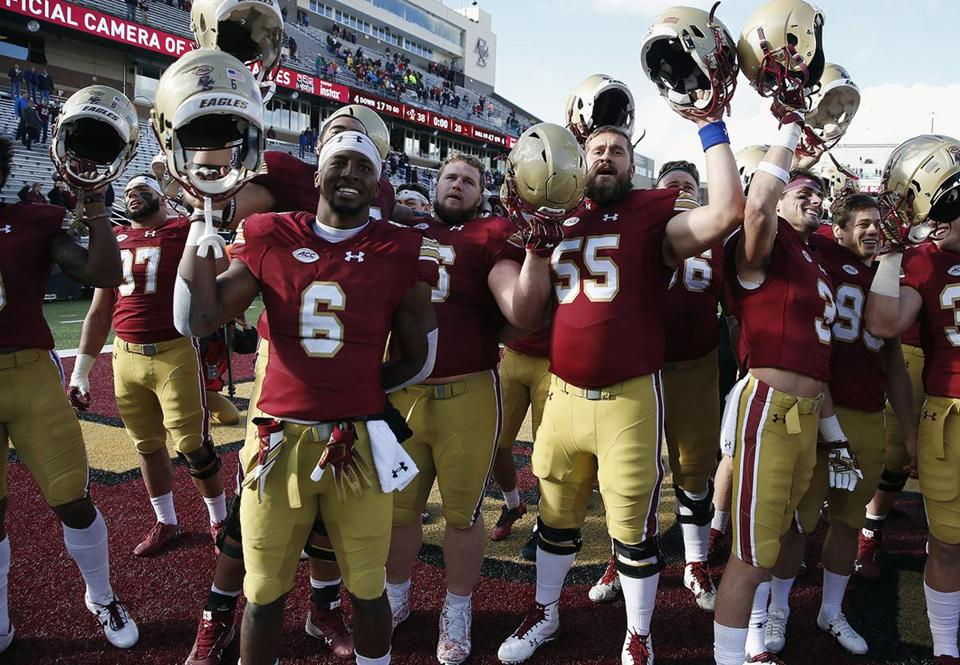 Boston College players celebrate after defeating Louisville during an NCAA college football game in Boston, Saturday, Oct. 13, 2018. (AP Photo/Michael Dwyer)
