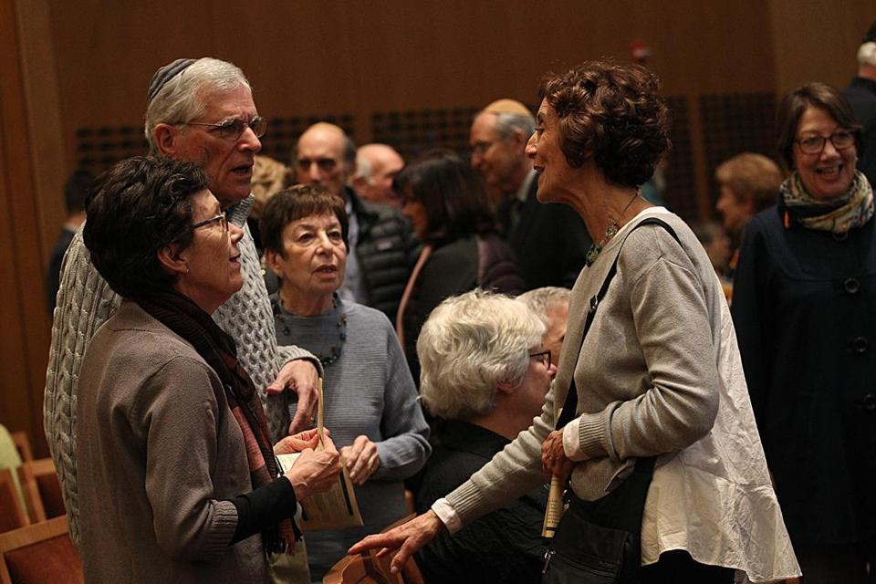 Bonnie Rosenberg (right) greeted fellow temple members at Temple Beth Elohim before Shabbat service was held on Friday night.