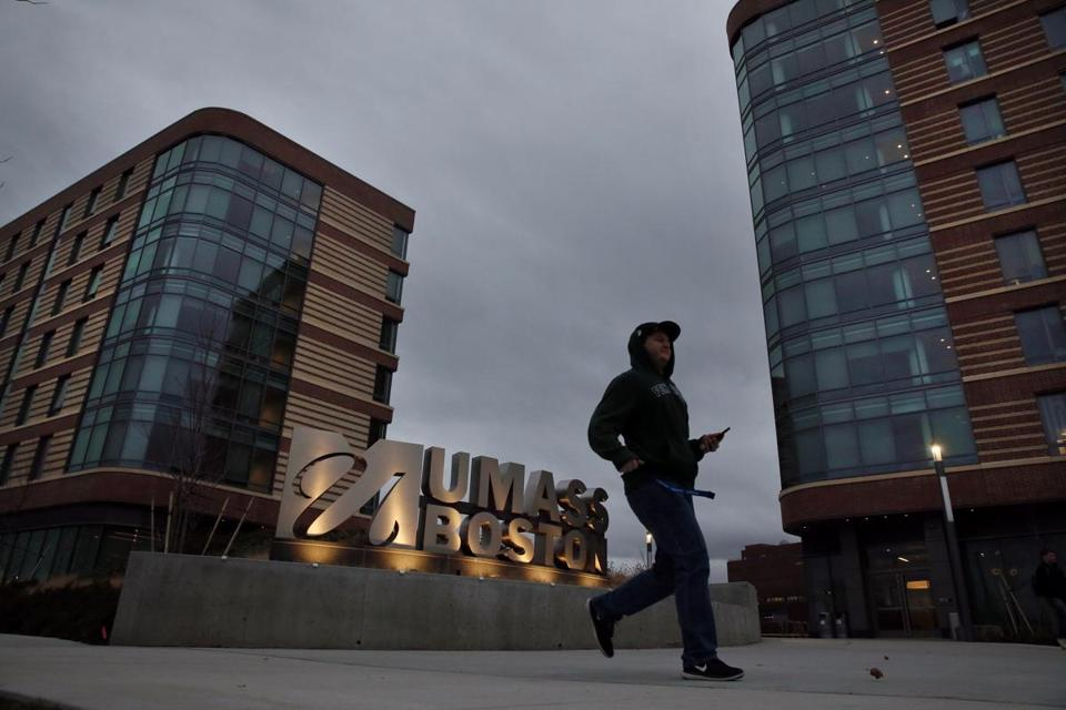 A student walked by the new dorms at the University of Massachusetts in Boston on Friday.