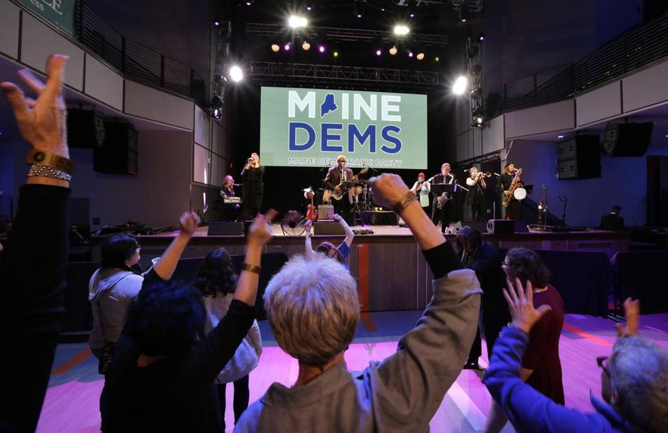 People danced at a Maine Democratic Party event on election night in Portland.