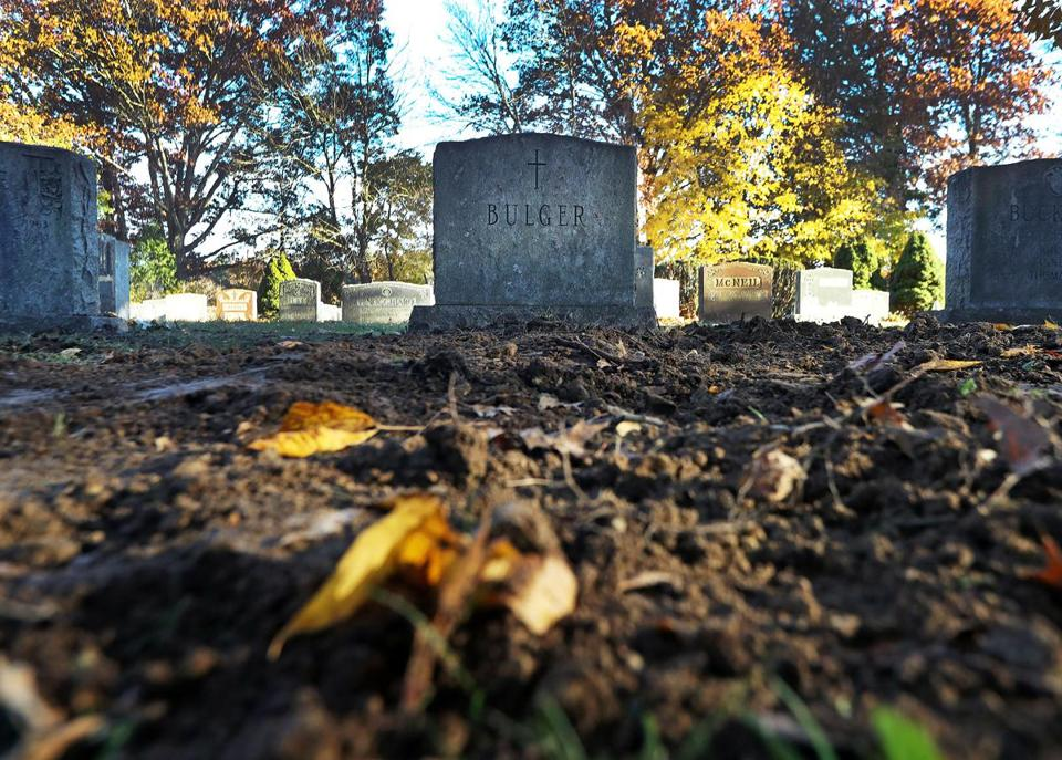 "West Roxbury, MA: 11-8-18: The freshly dug up dirt is pictured in front of a headstone where James ""Whitey Bulger was buried today at St. Joseph's Cemetery. The headstone bears the names of his parents. (Jim Davis/Globe Staff)"