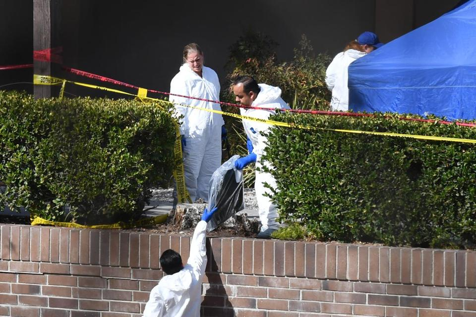 Investigators worked at the scene of the mass shooting at the Borderline Bar and Grill in Thousand Oaks, Calif., Thursday.