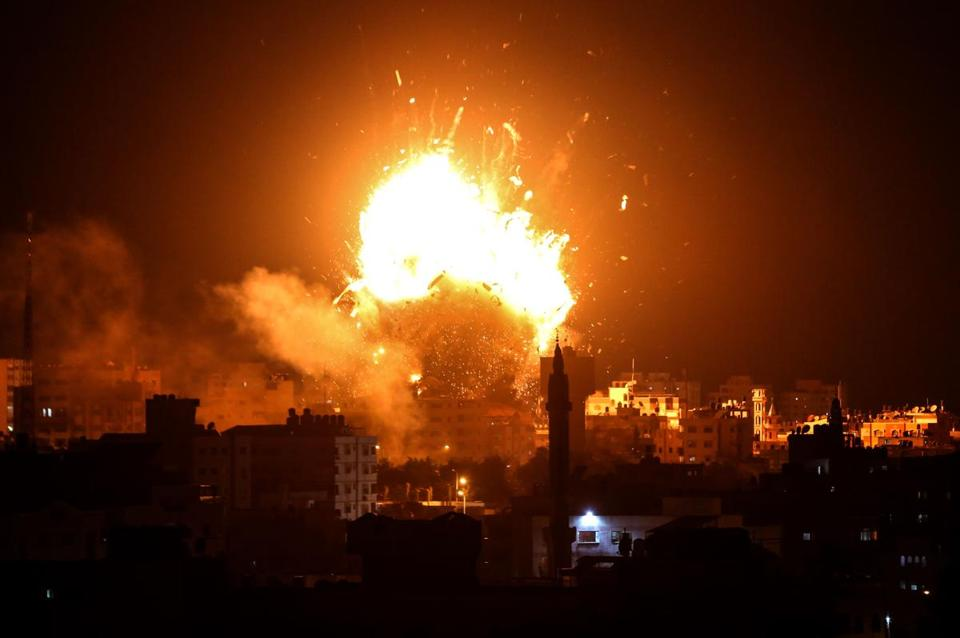 "A picture taken on November 12, 2018 shows a ball of fire above the building housing the Hamas-run television station al-Aqsa TV in Gaza City during an Israeli air strike. - Israel's military said it was carrying out air strikes ""throughout the Gaza Strip"" after rocket fire from the Palestinian enclave towards its territory. (Photo by Bashar TALEB / AFP)BASHAR TALEB/AFP/Getty Images"
