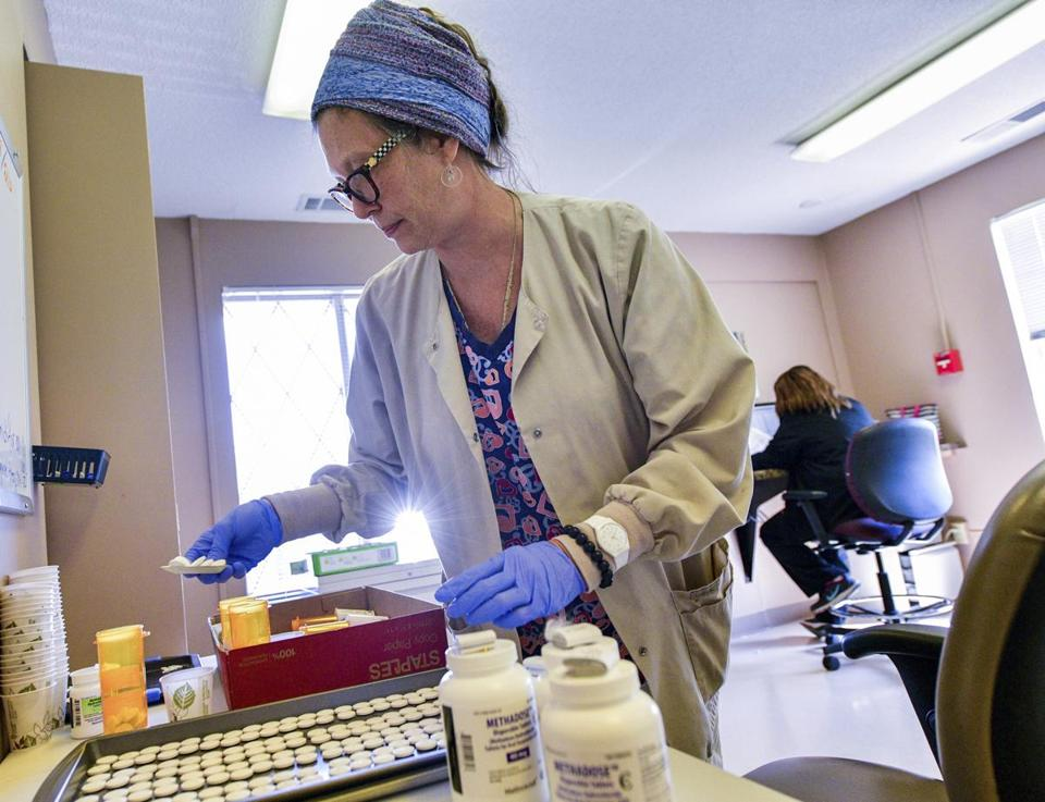 Registered nurse Teresa Smith prepared doses of methadone in the lab at the Human Service Center in Peoria, Ill.