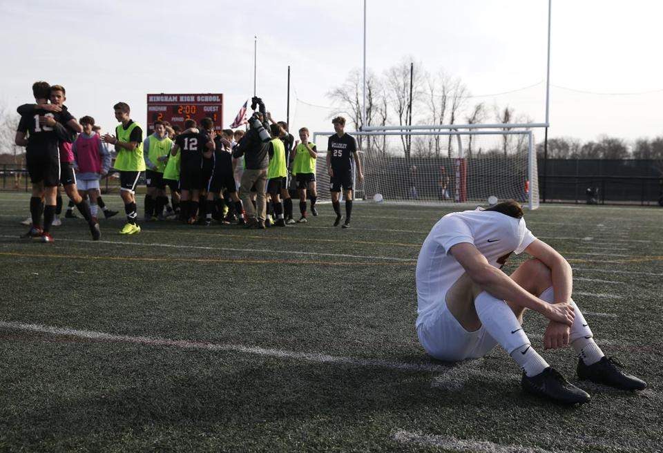 BC High's Jack Linnehan takes a moment for himself as Wellesley celebrate its victory in the Division 1 South final.