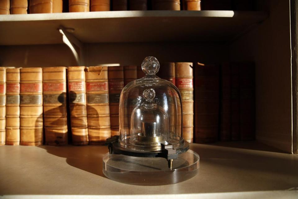 A replica of the International Prototype Kilogram at the International Bureau of Weights and Measures, in Sevres, France. The golf ball-sized metal cylinder at the heart of the world's system for measuring mass is heading into retirement.