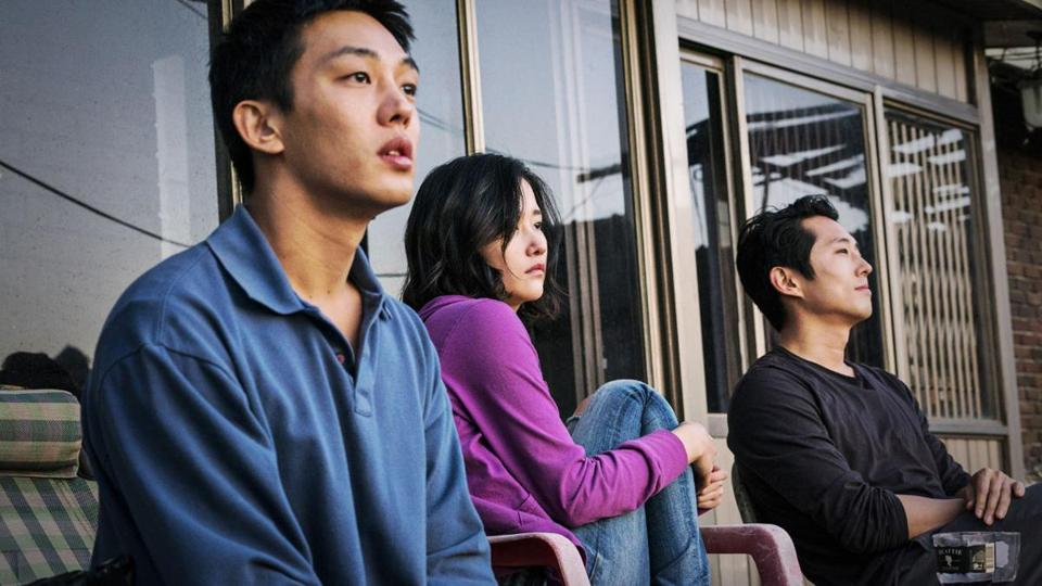 "Yoo Ah-in, Jun Jong Seo, and Steven Yeun in the film ""Burning."""