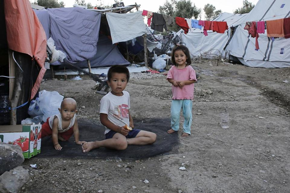MORIA, GREECE - SEPTEMBER 24: Children play at a makeshift camp outside of Moria Reception center at Moria Refugee Camp on September 24, 2018 in Moria, Greece. On Monday 24th of September, 444 migrants were moved to Athens from Moria, Greeces largest migrant camp situated on the Island of Lesbos. Despite this, more than 10,000 people still reside in the overcrowded camp, which has the capacity to host only 3000 people, with more arriving from Syria, Afghanistan, Iraq and The DRC each week. The camp is filled with rubbish, psychological trauma goes untreated and unsanitary conditions and violence are commonplace. Since 2015 the EU has allocated more than 1.6bn Euros to address the crisis but little of this money has been dispersed. (Photo by Milos Bicanski/Getty Images)