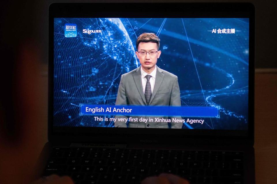This photo illustration shows a man watching an artificial intelligence (AI) news anchor from a state-controlled news broadcaster, on his computer in Beijing on November 9, 2018. - China's state-controlled news broadcasters have long been considered somewhat robotic in their daily recitation of pro-government propaganda, and a pair of new presenters will do little to dispel that view. (Photo by Nicolas ASFOURI / AFP)NICOLAS ASFOURI/AFP/Getty Images