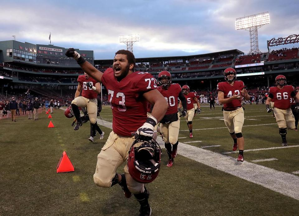 Harvard offensive lineman Larry Allen (73) and teammates celebrate their 45-27 win over Yale.