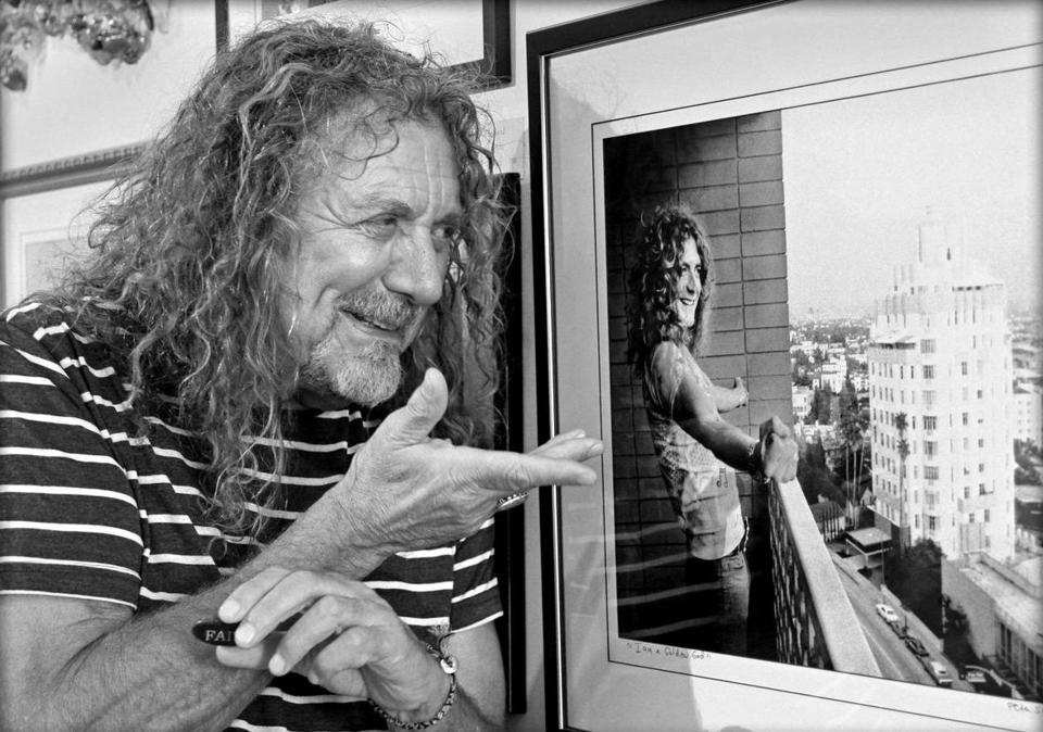14names - Robert Plant of Led Zeppelin at Peter Simon's gallery on Martha's Vineyard. Plant is admiring a picture simon took of him in 1975 in LA. (Peter Simon)