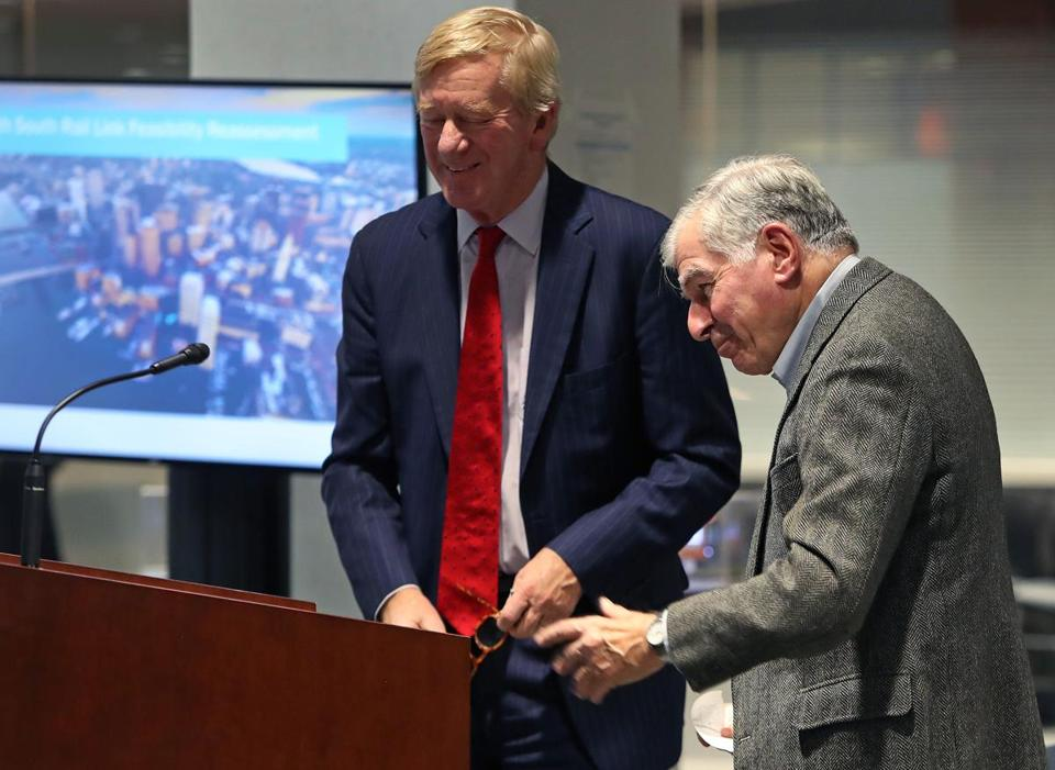 Former Massachusetts governors William Weld (left) and Michael Dukakis united again Monday to restate their support for the North-South Rail Link.