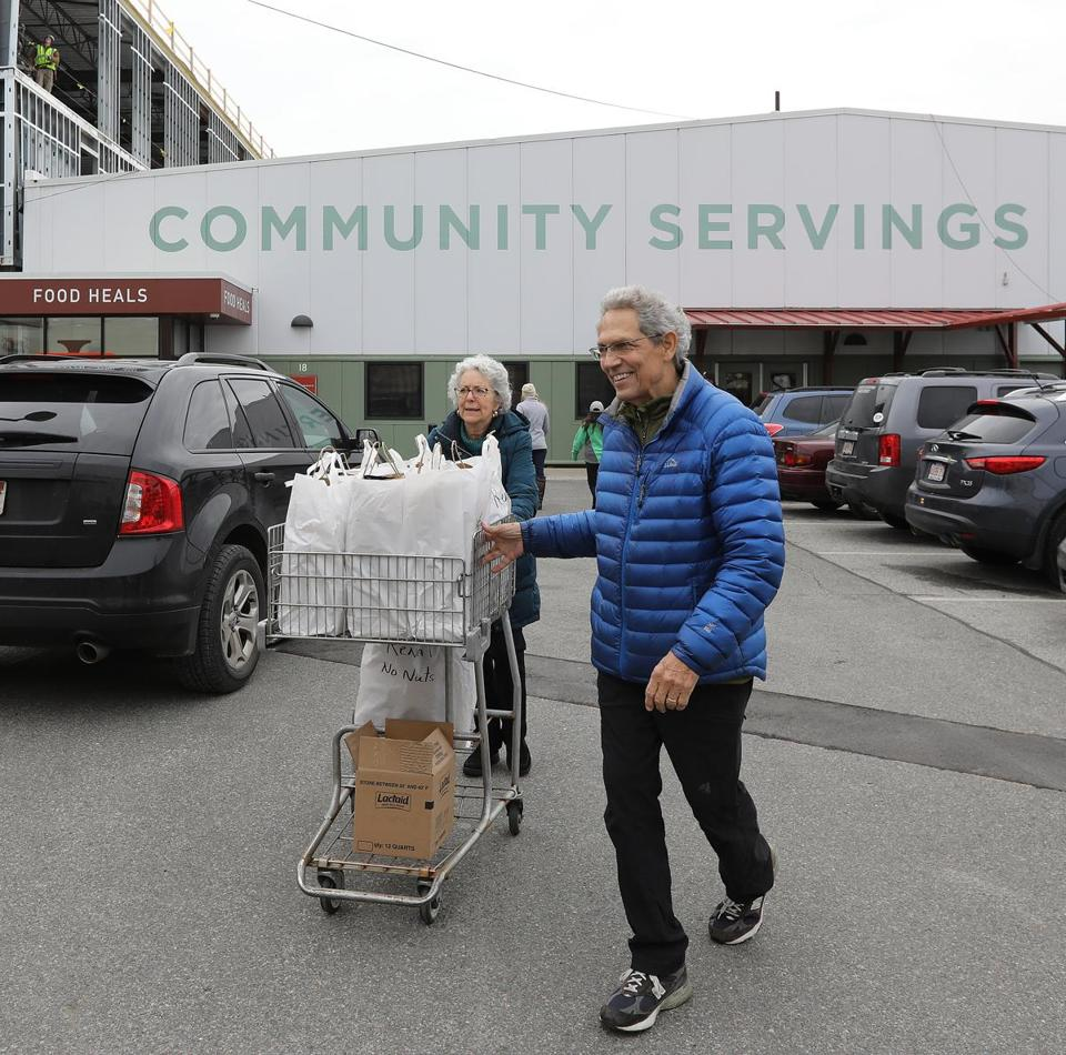 Boston, MA - 11/21/18 - The husband-wife team of Jon Truslow (cq) and Sharryn Ross (cq) has been volunteering at Community Servings (cq) for 30 years. The couple leaves the Jamaica Plain facility (which is expanding with the construction at left rear) to deliver meals to people in the Boston area, who are ill or disabled. Photo by Pat Greenhouse/Globe Staff Topic: 22foodvolunteerMetro Reporter: Laura Crimaldi