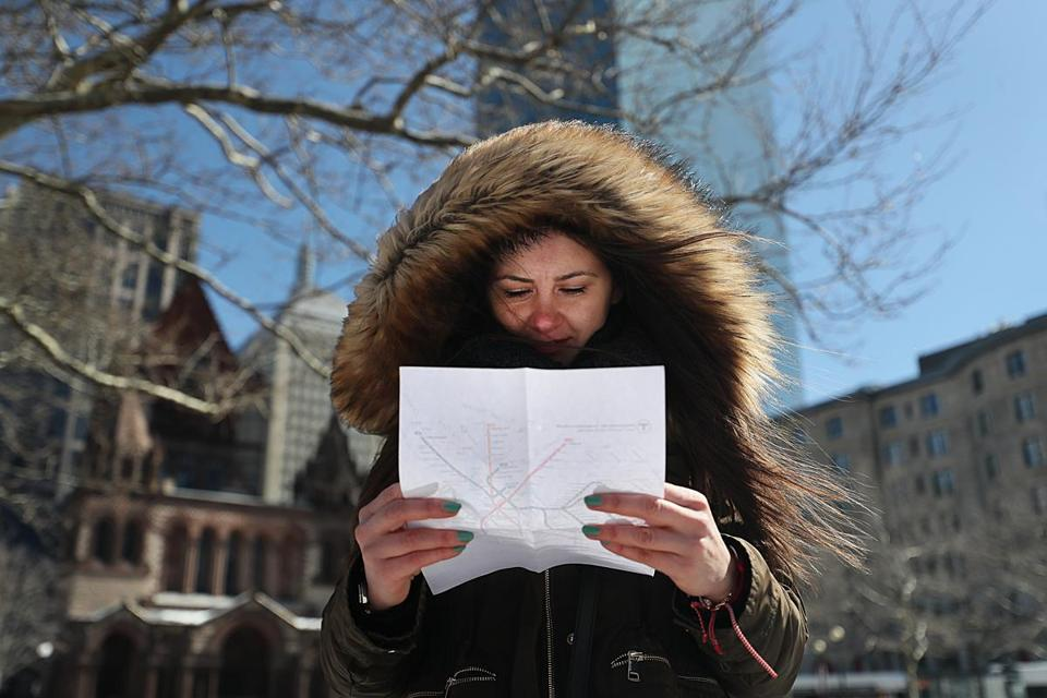 Tourist Veronika Kashayova studied a T map in Copley Square.