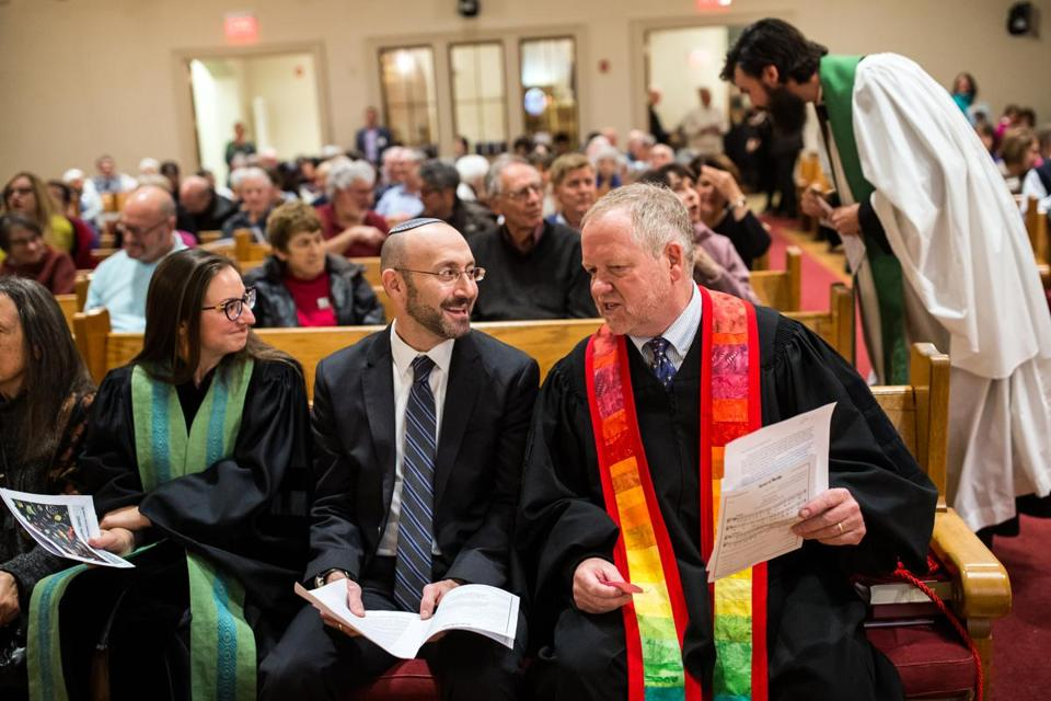 Rabbi David Lerner (center) of Temple Emunah joined Rev. Paul Shupe during an interfaith service in Lexington.