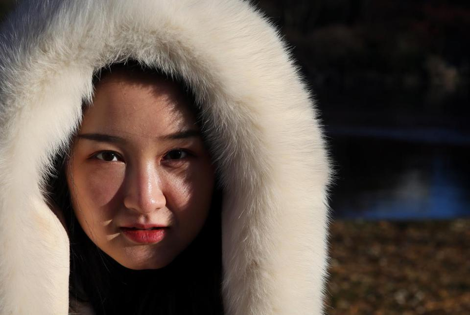 Meisha Duan of Los Angeles was dressed for the cold while visiting Boston on Thursday.