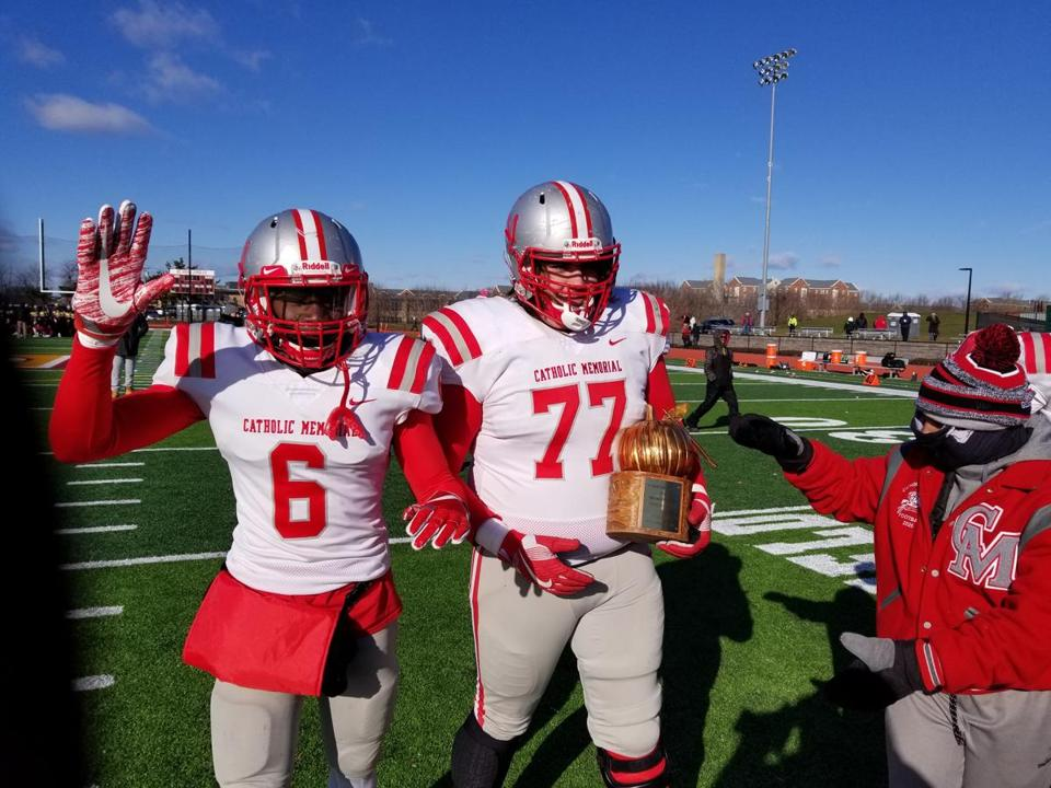 Catholic Memorial seniors Devon Williams, left, and Hunter Salmon celebrate their Thanksgiving Day win over BC High.