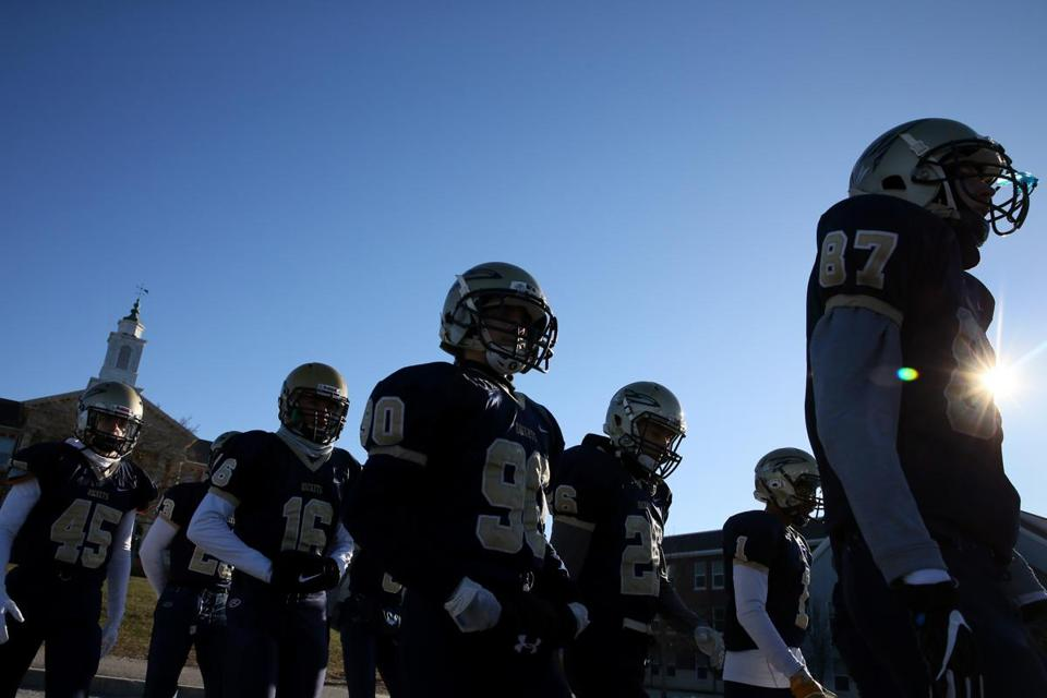 Needham, MA - November 22, 2018: Members of the Needham High School football team take the field prior to their 131st meeting with Wellesley High School in Needham, MA on November 22, 2018. High temperatures are only expected to reach the low 20s across Massachusetts, according to the weather service, and the wind chill will make it feel much colder during the morning hours. (Craig F. Walker/Globe Staff) section: metro reporter:
