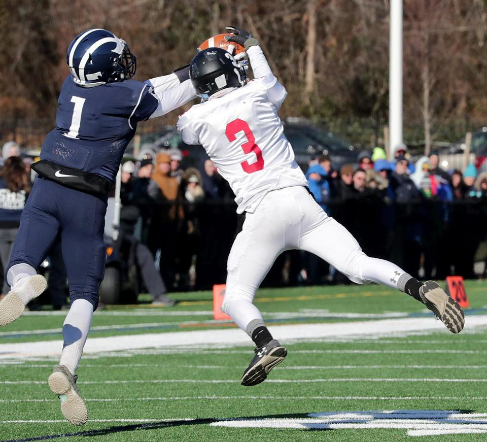 Swampscott, MA: 11-22-2018: Swampscott High School's Arturo Vasquez (no. 1, left) and Marblehead's Sean McCarthy (no. 3) battled for the ball, but McCarthy came up with interception during Thanksgiving Day football game in Swampscott, Mass., Nov. 22, 2018. Photo/John Blanding, Boston Globe staff story/Charlie Wolfs, Sports ( 23schswampscott )