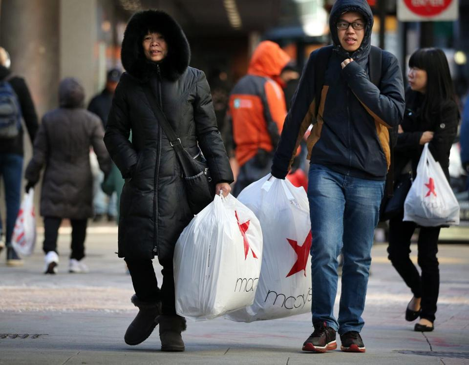 Shoppers bundled up against the cold as they did their Black Friday shopping in Downtown Crossing.