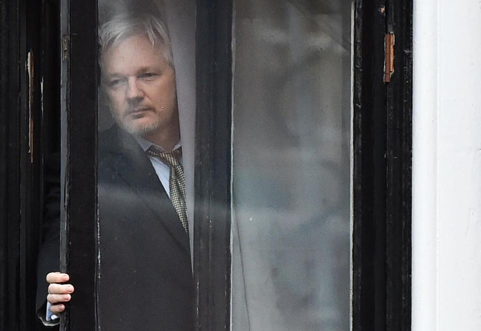 "(FILES) In this file photo taken on February 05, 2016 WikiLeaks founder Julian Assange comes out on the balcony of the Ecuadorian embassy to address the media in central London on February 5, 2016. - WikiLeaks founder Julian Assange is suing the Ecuador government for violating his ""fundamental rights"" in the country's London embassy where he has been living since 2012, the whistleblowing website said on on October 19, 2018. (Photo by BEN STANSALL / AFP)BEN STANSALL/AFP/Getty Images"