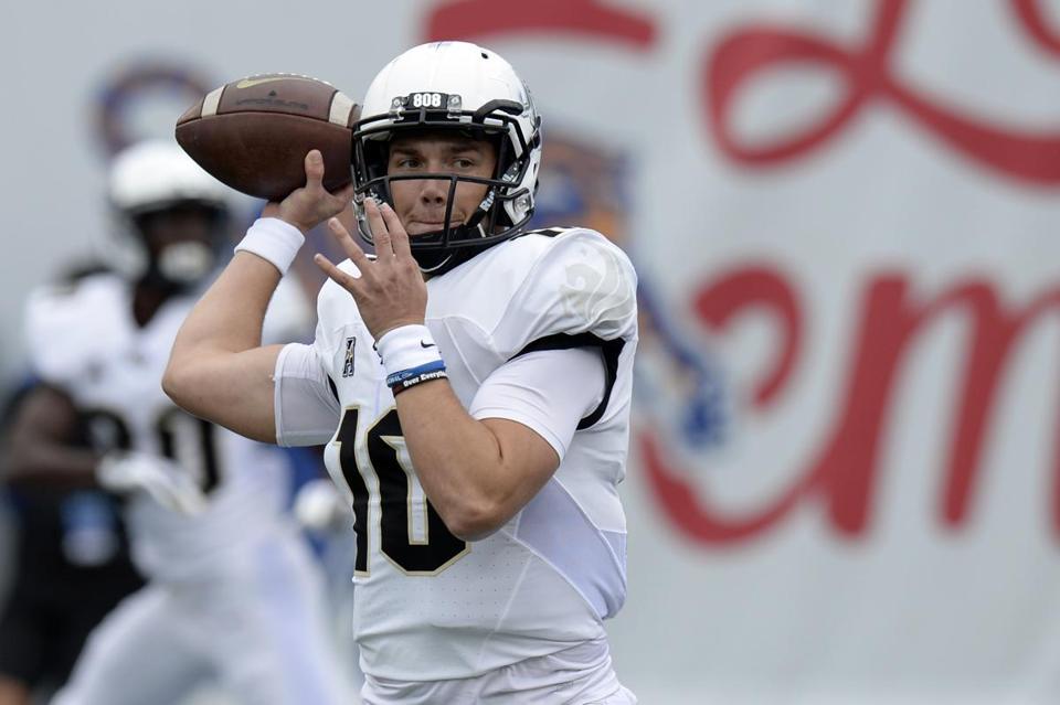 Central Florida quarterback McKenzie Milton warms up before an NCAA college  football game against Memphis Saturday c519bd6fd