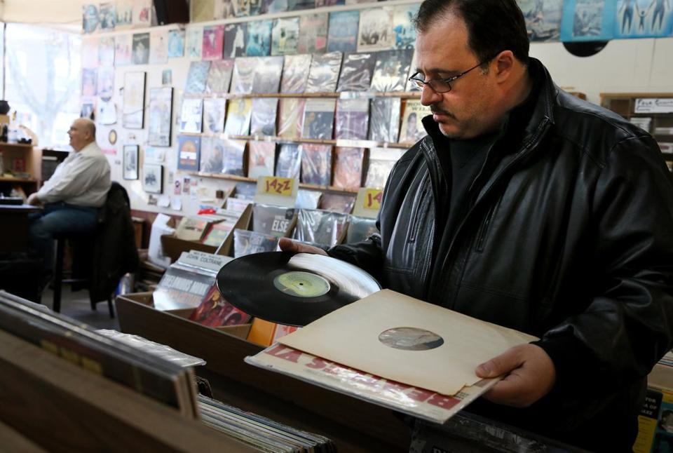 On the hunt for treasure, Gerald Fusco eyed the shelf of LPs for sale inside Stereo Jack's Records in Cambridge Saturday.