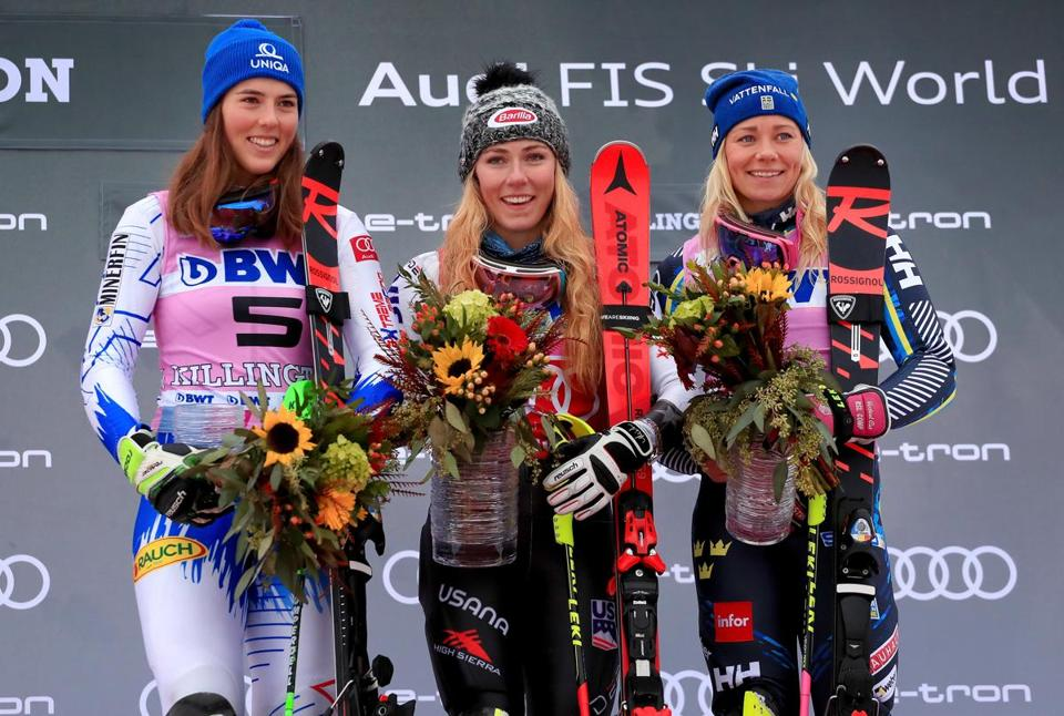Petra Vlhova (left) in second place, Mikaela Shiffrin (center) in first place and Frida Hansdotter in third celebrate on the podium during the women's slalom during the Killington World Cup.