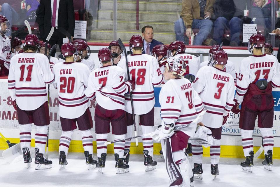 Umass Amherst hockey head coach Greg Carvel (C) has a talk with his team during a break in the game against Princeton in the second period at the Mullins Center in Amherst, Massachusetts on November 24, 2018. UMass defeated Princeton 3-2 in overtime. Matthew Healey for The Boston Globe