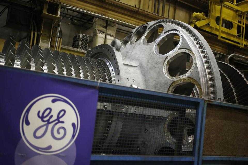 A logo is displayed next to a gas turbine at the General Electric energy plant in Greenville, South Carolina, on Jan. 10, 2017. MUST CREDIT: Bloomberg photo by Luke Sharrett.