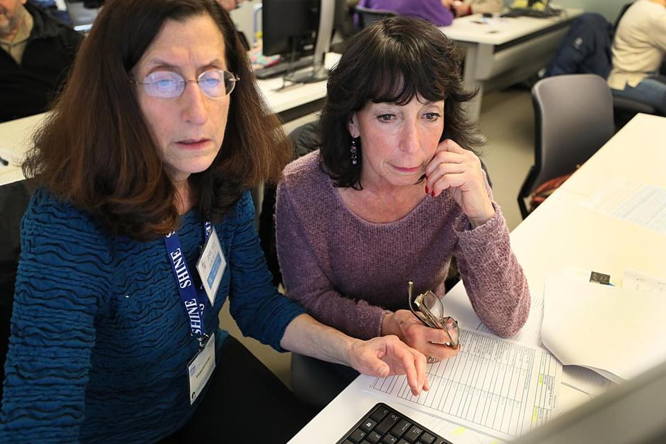 Counselor Margaret Leidler (left) offered some guidance on Medicare to Phyllis Bernstein and others at the Needham Senior Center.